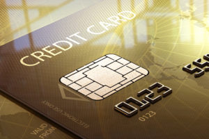 Glossy Credit Card Close-up in front of window (Elements of this image furnished by NASA - map derived from http://visibleearth.nasa.gov)